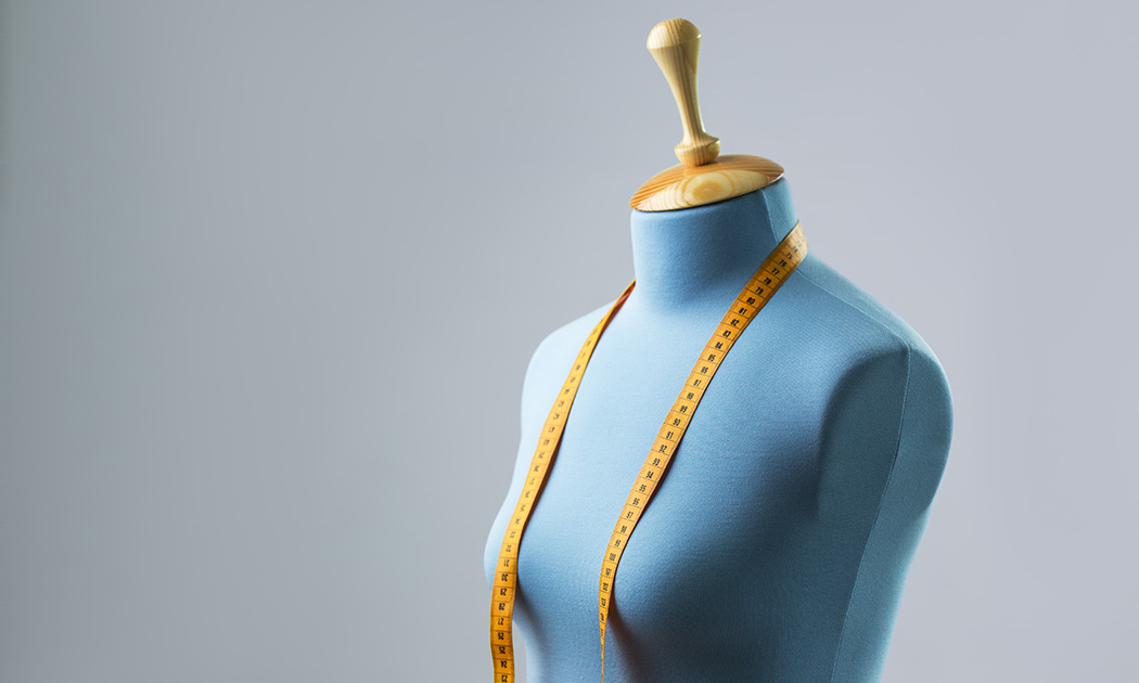 Blue dress form with measuring tape